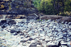 Wild north nature landscape. lot of rocks on lake shore Stock Photo