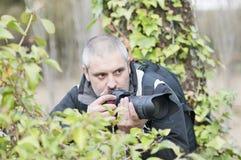 Wild photographer. Royalty Free Stock Photo
