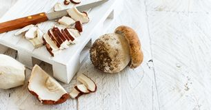 Wild porcino mushrooms sliced on a wooden board Royalty Free Stock Photo