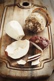 Wild porcino mushrooms. On a wooden board close up Royalty Free Stock Photos