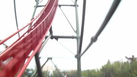 Wild pov of riders and roller coaster track stock video
