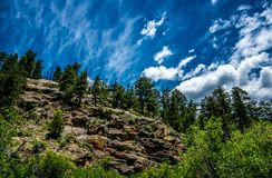 Blue sky and rocks. The picturesque nature of the Rocky Mountains. Colorado, United States. Wild primeval nature of the Rocky Mountains in Colorado, USA Stock Images