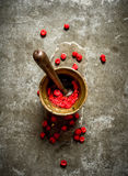 Wild raspberries in old mortar with pestle. Stock Photography