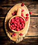 Wild raspberry in the Cup. On a wooden table Stock Photography