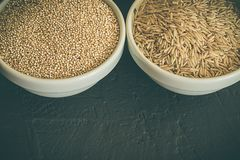 Wild raw brown rice and raw quinoa in a bowl. Healthy whole food. royalty free stock photography