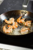 Wild red argentine shrimp fried in the pan in butter with garlic and sesame seeds Royalty Free Stock Photography