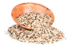 Wild rice. And bamboo bowl over a white background Royalty Free Stock Photography