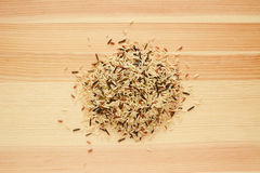 Wild rice, brown basmati and red camargue grains on wood Stock Photography