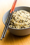 Wild rice in ceramic bowl and chopsticks Royalty Free Stock Photography