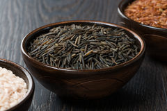 Wild rice in ceramic bowl Stock Photo
