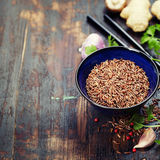 Wild rice in ceramic bowl and ingredients Royalty Free Stock Image