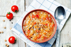 Wild rice chickpeas tomatoes cabbage soup. Toning. selective focus Stock Photos