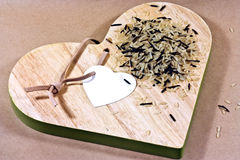 rice on heart shaped board Royalty Free Stock Image