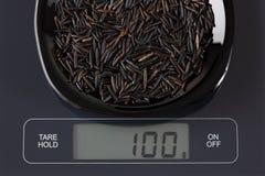 Wild rice on kitchen scale Royalty Free Stock Photos