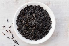 Wild Rice. Minnesota Cultivated Wild Rice in a Bowl Stock Photo