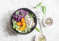 Wild rice, roasted pumpkin, red cabbage buddha bowl. Vegetarian food concept. On a light background. Top view Royalty Free Stock Photos