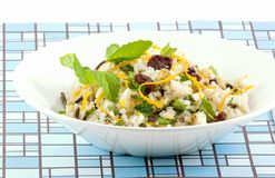 Wild rice salad. Long grain and wild rice combined with walnuts, dried cherries, mint and zest of an orange combine to make a refreshing salad Royalty Free Stock Photography