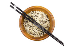 Wild rice with sticks in wooden bowl Stock Image