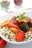 Wild Rice  with vegetables in tomato sausages Royalty Free Stock Images