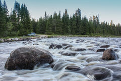 Wild river with camping spot Stock Images