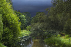 Wild river. Clouds over the river. Clouds over the river. Cloudy and sunny Stock Images