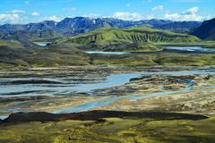 Wild river delta with mountains, Iceland Royalty Free Stock Images