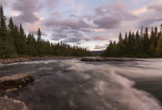 Wild river flowing freely in Sarek national park, Sweden. Staying in the kvikkjokk fjallstation the river is close. Its a pleasure taking photo`s of the river stock photography