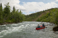 Wild, river rapid canoeing in remote Alaska Stock Photography