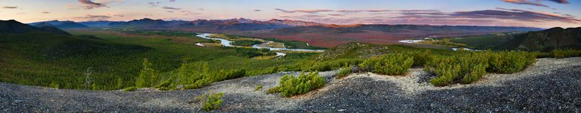 Wild river valley at sunset. Panorama of the valley of the river during the autumn evening dawn Royalty Free Stock Image