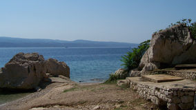 Wild rocky beach in Croatia. Beautiful beach in Croatia full of rocks and pebbles Royalty Free Stock Photography