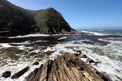 Rocky coast line in Storms River in Tsitsikamma National Park, South Africa Royalty Free Stock Photo