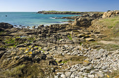 Wild rocky coastline in south-east of Yeu Island. It's the landscape of Wild Rocky Coastline in South-East of Yeu Island with textured stones at foreground Royalty Free Stock Photography