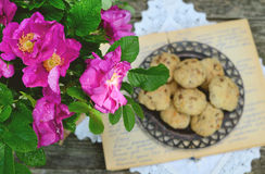 Wild rose bunch and homemade cookie Royalty Free Stock Image