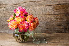 Wild roses bouquet in glass vase. Wild roses bouquet in a glass vase stock photo