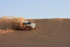 Wild safari. Jeep going wild in the yellow desert sand of a dubai desert royalty free stock image