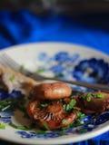 Wild Saffron Milk Cap cooked on rustic plate stock photo