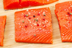 Wild Salmon coated with Sea Salt and Peppercorn Royalty Free Stock Photos