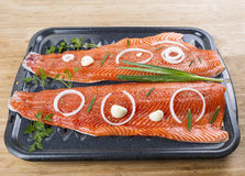 Wild Salmon Fillets And Herbs In Baking Pan On Wood Background Royalty Free Stock Images