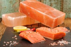 Wild salmon salted with himalayan pink salt blocks, lemon and ch Royalty Free Stock Image