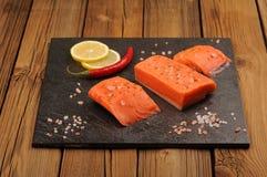 Wild salmon salted with himalayan pink salt, lemon and chili on Royalty Free Stock Photo