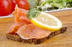 Wild salmon slices on rye bread Stock Photos
