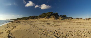 Wild sand dune,ocean,clouds and blu sky Royalty Free Stock Image