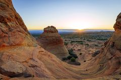 Wild sandstone mesa sunrise in the desert southwest, Utah, USA. Sunrise mesa with unique rocks glowing in the desert southwest landscape, Arizona, USA Royalty Free Stock Photo
