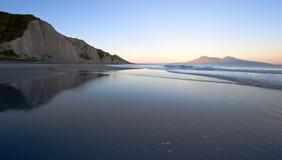 Wild sea coast at sunrise. stock images