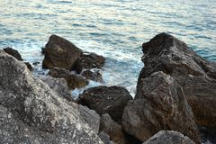 Free Wild Sea Panorama Surrounded With Sharp Rock Stones In Summer On Sunny Sunset Day. Beauty And Force Of Deep Water Royalty Free Stock Image - 141556826