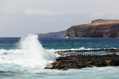 Big wave breaking with violence by natural pools in Agaete, Gran Canaria. Wild sea by popular travel attraction on the coast in Canary Islands, Spain. Leisure stock photography