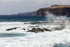Natural pools in Agaete, Gran Canaria. Wild sea by popular travel attraction on the coast in Canary Islands, Spain. Leisure time, tourism, visit, guided tour royalty free stock photography