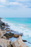 Wild sea shore and stones close background in Cuba Royalty Free Stock Photography