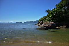 Wild seashore. With sand, rocks and forest in Rio de Janeiro state, Brazil Royalty Free Stock Photography