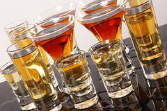 Wild shooters. Shooters with whiskey, tequila and rum Royalty Free Stock Images